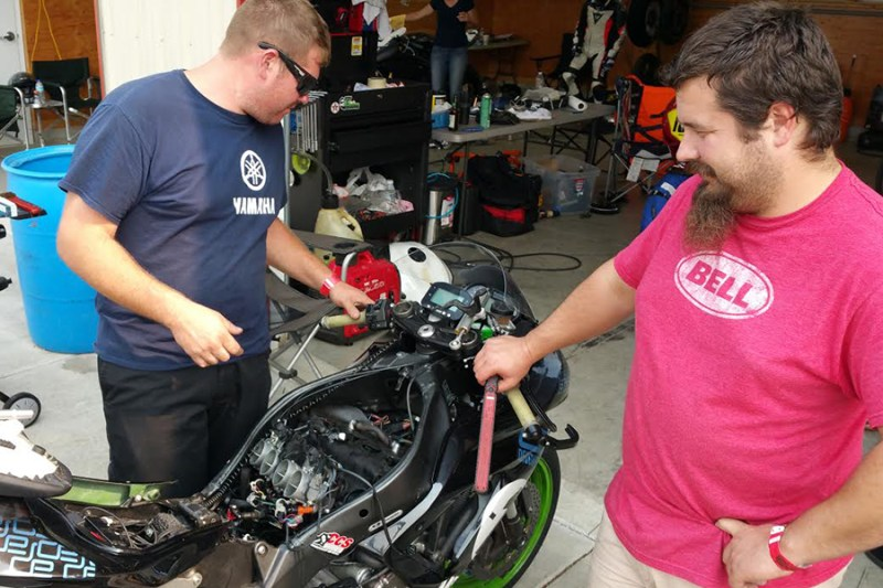 Jimmy and Max discussing all the oil that filled the air box & injectors
