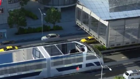 An elevator would be used to board passengers from street level onto the TEB.