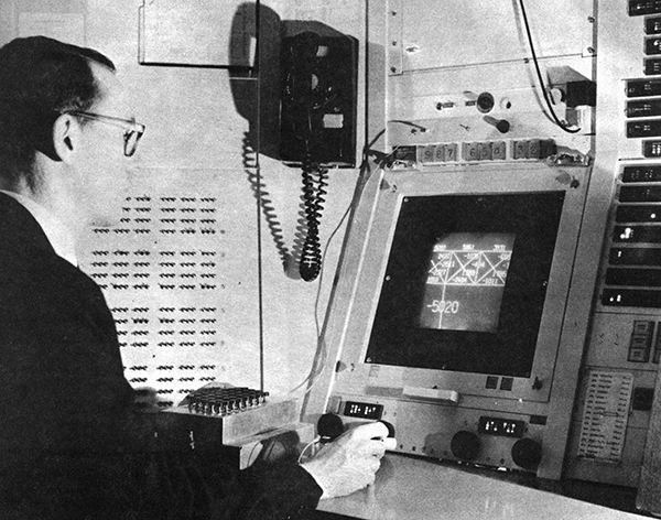 Ivan Southerland of Evans & Southerland using an early computer