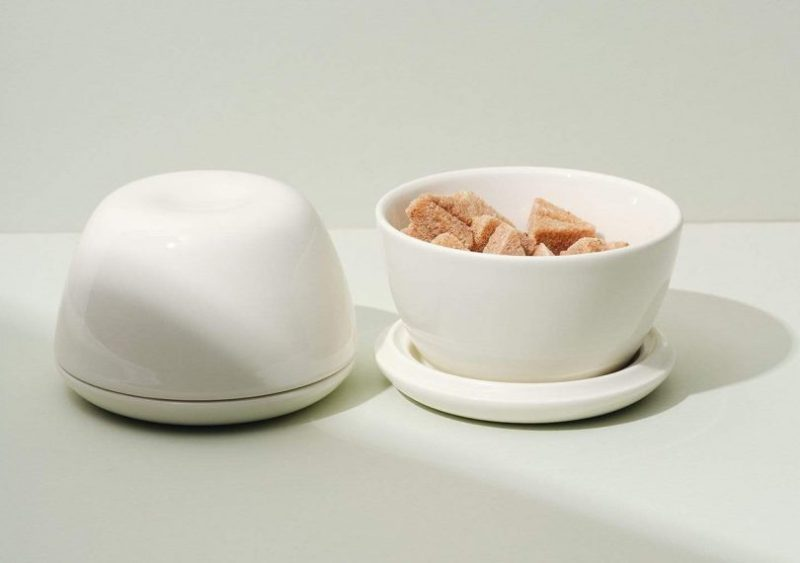 Fors Studio Switch Bowls on a light grey surface. One is full of sugar cubes and the other is flipped as a dome covered dish