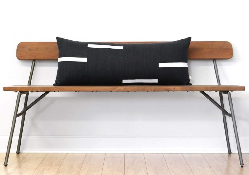 Interconnection pillow by jillian rene decor on a wooden bench