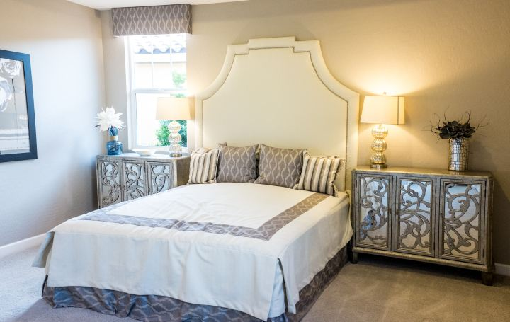 Upholstered headboard and bedroom creates a focal point for the room is an essential design tip
