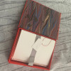 Noterious Boxed Notecard Set Blazing Red with Marbled Paper Open View Overhead