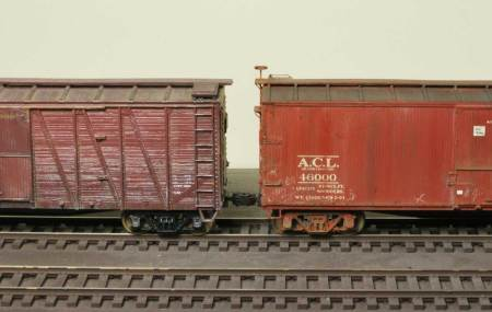 Compare the trucks of these two box cars. Follow the post for tips on weathering wheelsets and trucks.