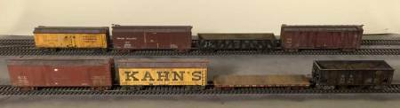 At long last, completed freight cars enter service on the layout.