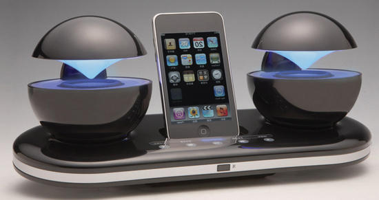 iCrystal dock with a pair of backlit omnidirectional speaker pods ...