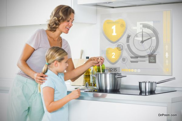 Mother and daughter making dinner using futuristic interface