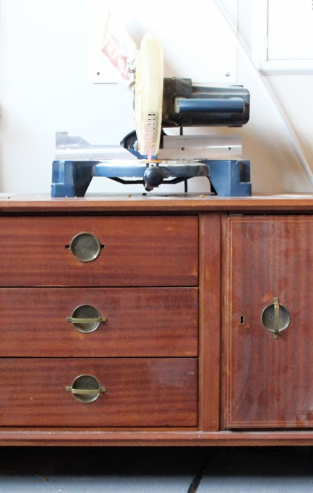 My Mid century credenza as a work bench for my chop saw.