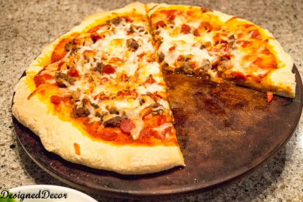Use a pizza stone to make your Meat Lovers Pizza