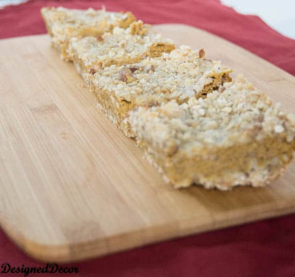 Cream Cheese Pumpkin Bars with chopped pecans - www.designeddecor.com