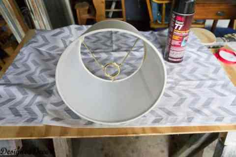 adding the fabric to the lamp shade