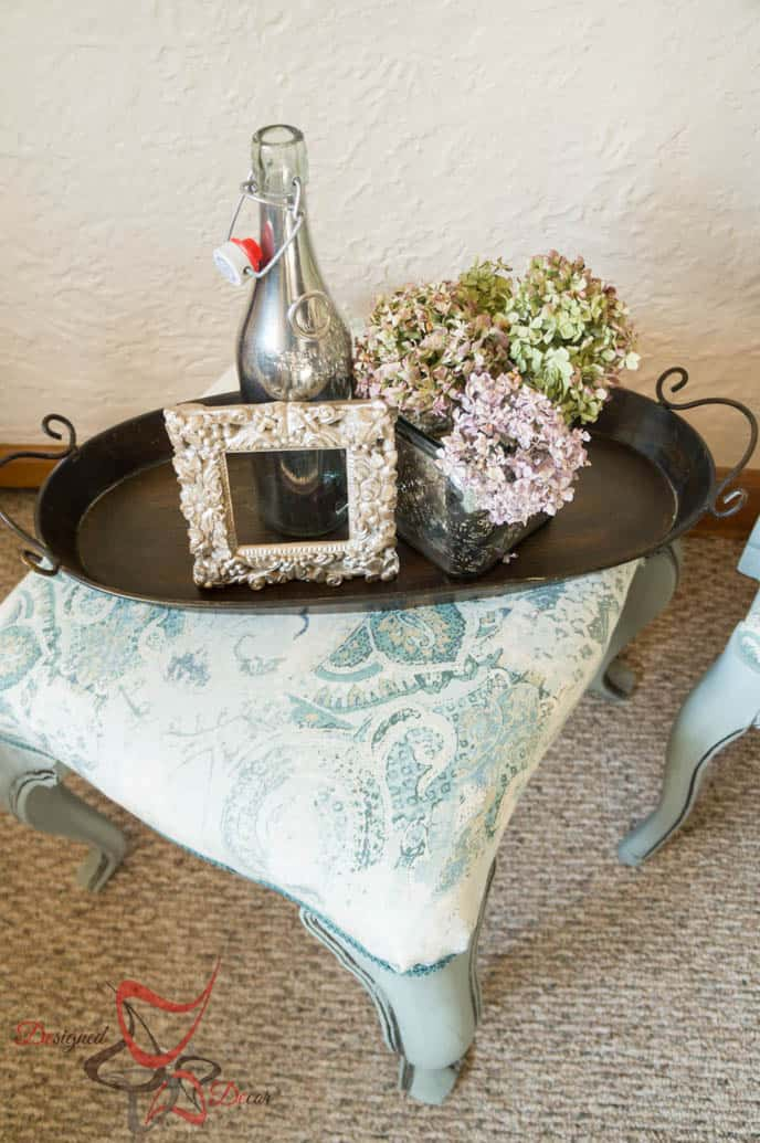foot rest with a decorative tray sitting on top