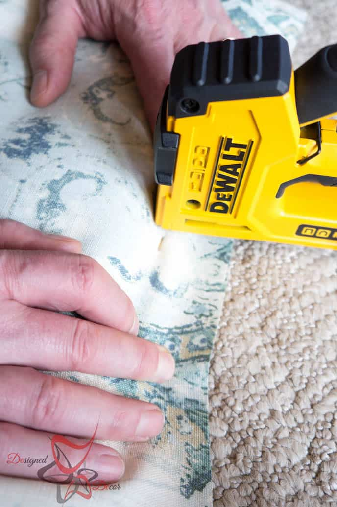 stapling fabric to the wood seat
