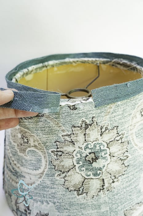 glue piping to edges of fabric covered lampshade