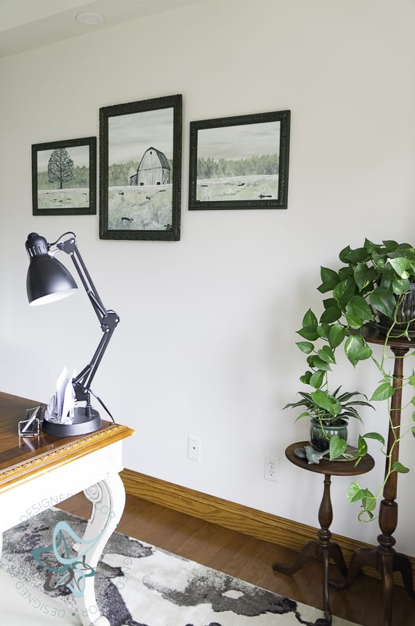hand painted barn scene in picture frames with plant stands in the corner