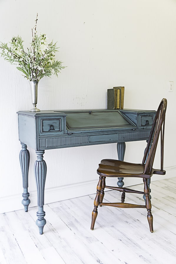blue painted desk with powder glazing and an antique chair