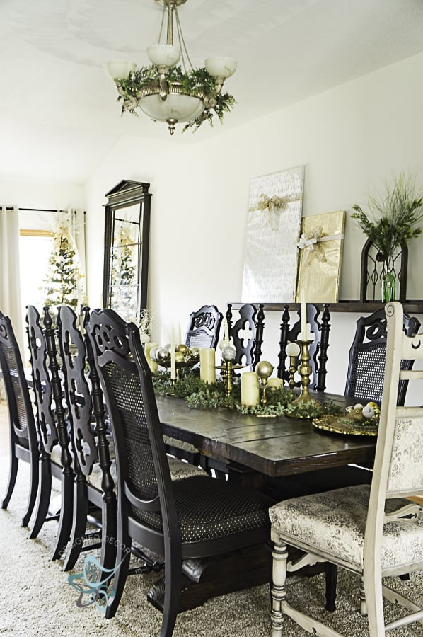 dining-table-with-Christmas-table-setting-of-brass-candlesticks-and-bulbs