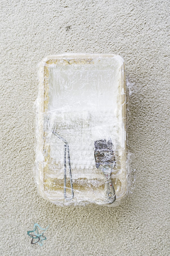 image of a paint tray wrapped with plastic wrap