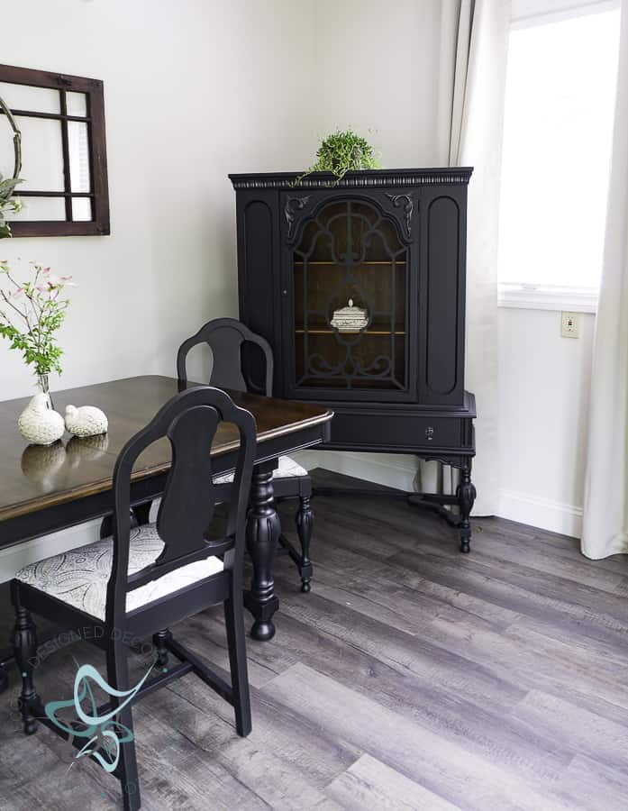 image of a black painted antique china hutch and dining table