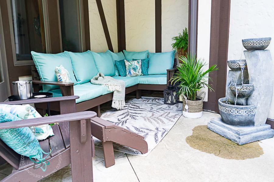 image of an outdoor seating area with a  DIY outdoor sectional sofa with decorative accessories