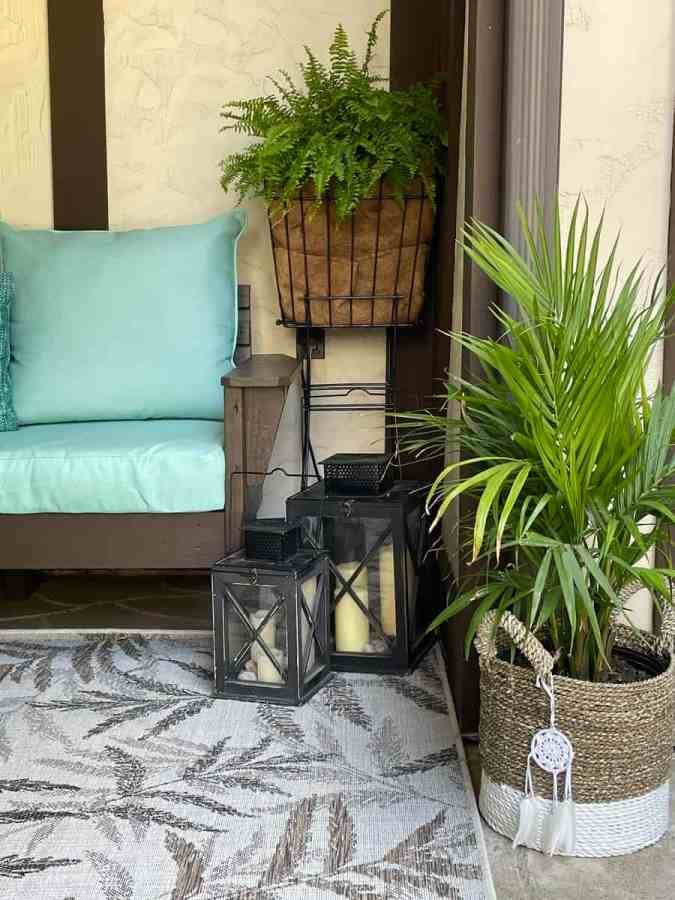 Image of a DIY outdoor sectional sofa with lanterns and plants