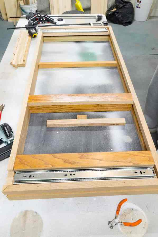 image of the wood frame being assembled with center support bars