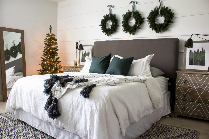 The last stop on the 2018 House Tour is our white and green Christmas bedroom. I added a few festive touches and a small tree with lights. | Designed Simple | designedsimple.com