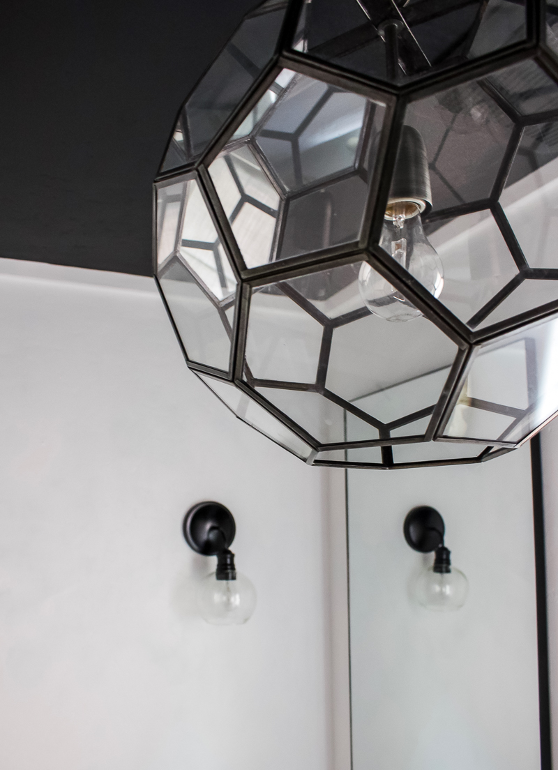 Make a bold statement in a small bathroom with a painted black ceiling! | Designed Simple | designedsimple.com
