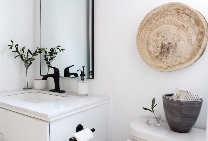 Pretty towels, wood trays, and marble accents - sharing some of my favorite simple bathroom decor that is both functional and beautiful. | Designed Simple | designedsimple.com