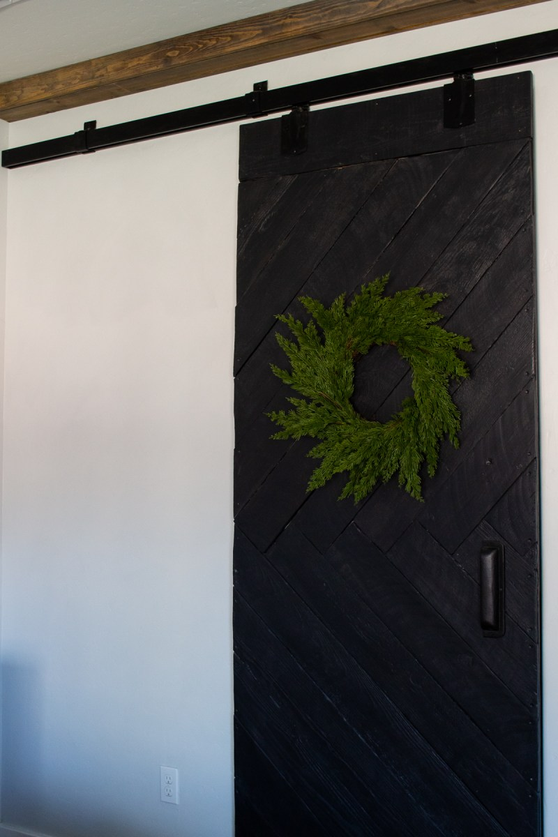 Lastly on the holiday house tour is our simple Christmas bedroom - prelit garland, wreaths & faux greenery are easy and add a festive touch. | Designed Simple | designedsimple.com
