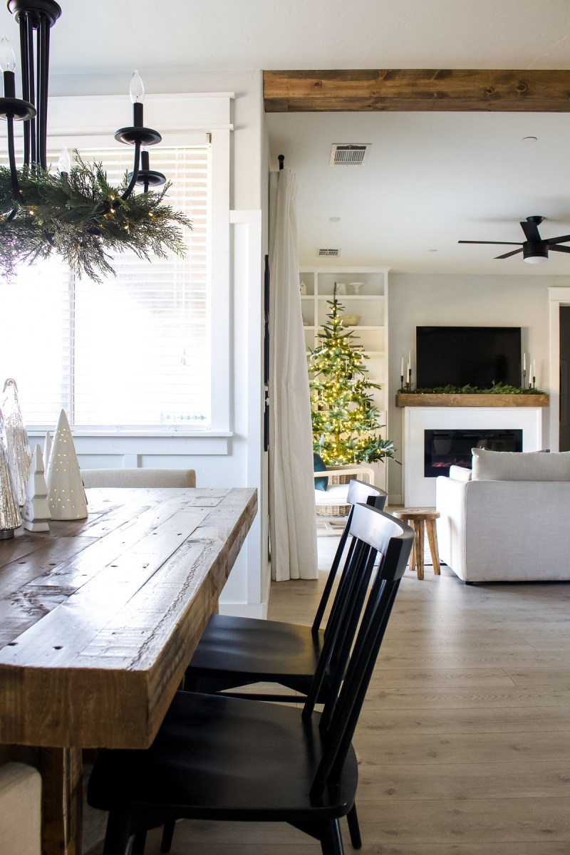 Sharing our simple Christmas dining room on the holiday house tour! See how I created a whimisal tree collection for a festive touch!   Designed Simple   designedsimple.com