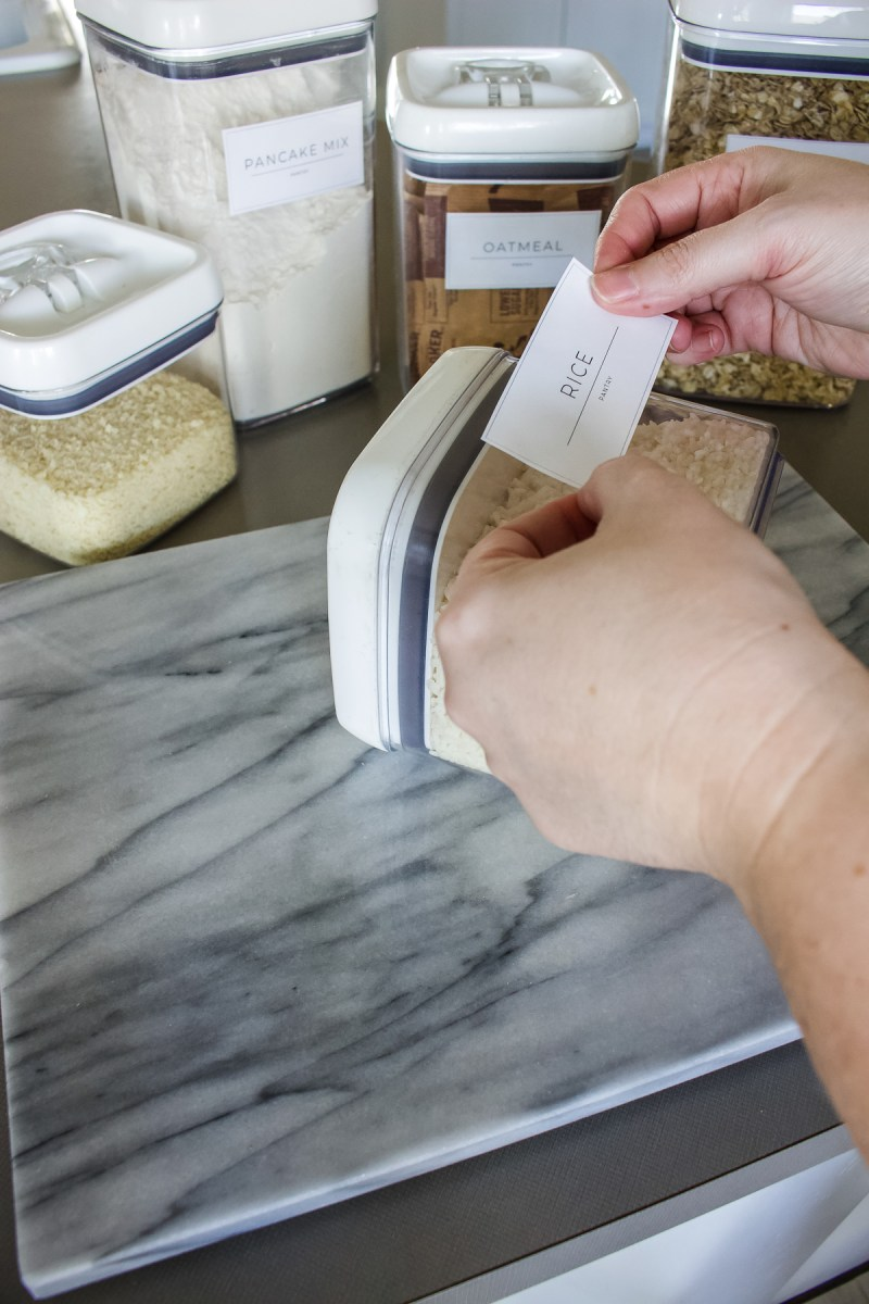 Create these DIY pantry & spice labels without any fancy equipment - just need a printer, scissors, packing tape and my FREE printable! | Designed Simple | designedsimple.com