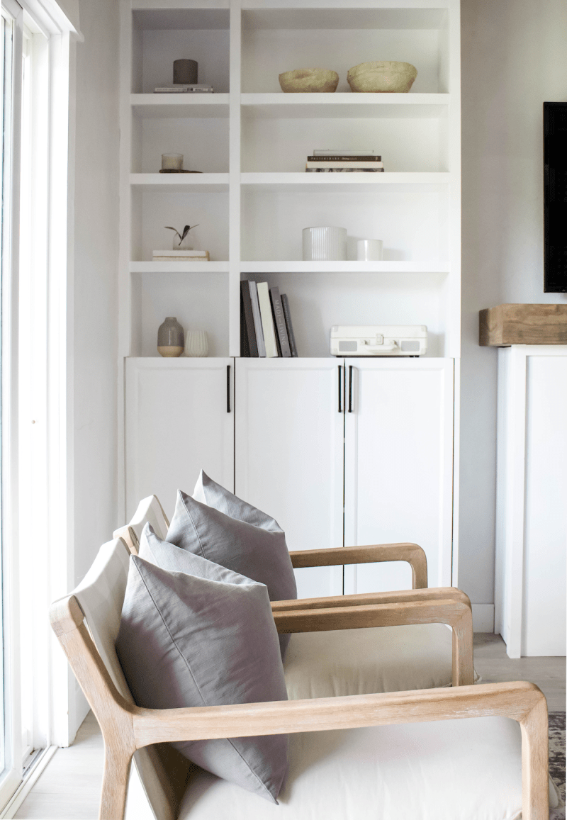 Inspired by the beach and sunshine, I'm sharing some of my favorite summer shelf decor and styling tips for a light and airy look! | Designed Simple | designedsimple.com