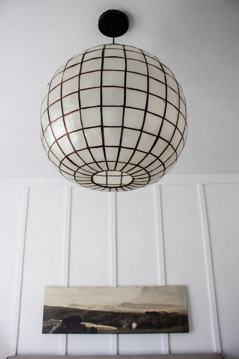 Sharing how to get the look of a popular Restoration Hardware light fixture with this DIY capiz shell pendant for a fraction of the price! | Designed Simple | designedsimple.com