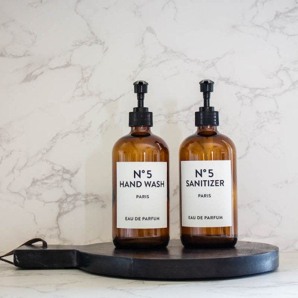 SHOP NOW! Amber glass bottle set with two amber glass bottles with simple white labels. Just add your favorite soap & sanitizer! | Designed Simple