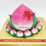 3D Shou Tao Longevity Bun Cake, surround with mini sugar shou tao. 3D长寿/寿桃包子型 蛋糕。