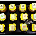 Mahjong tiles customized fondant cupcakes.