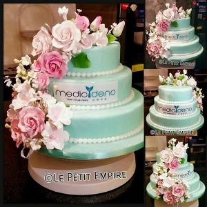Sugar Flower Cake - 3 Tier Turquoise Fondant Cake, with company logo and cascading flowers.