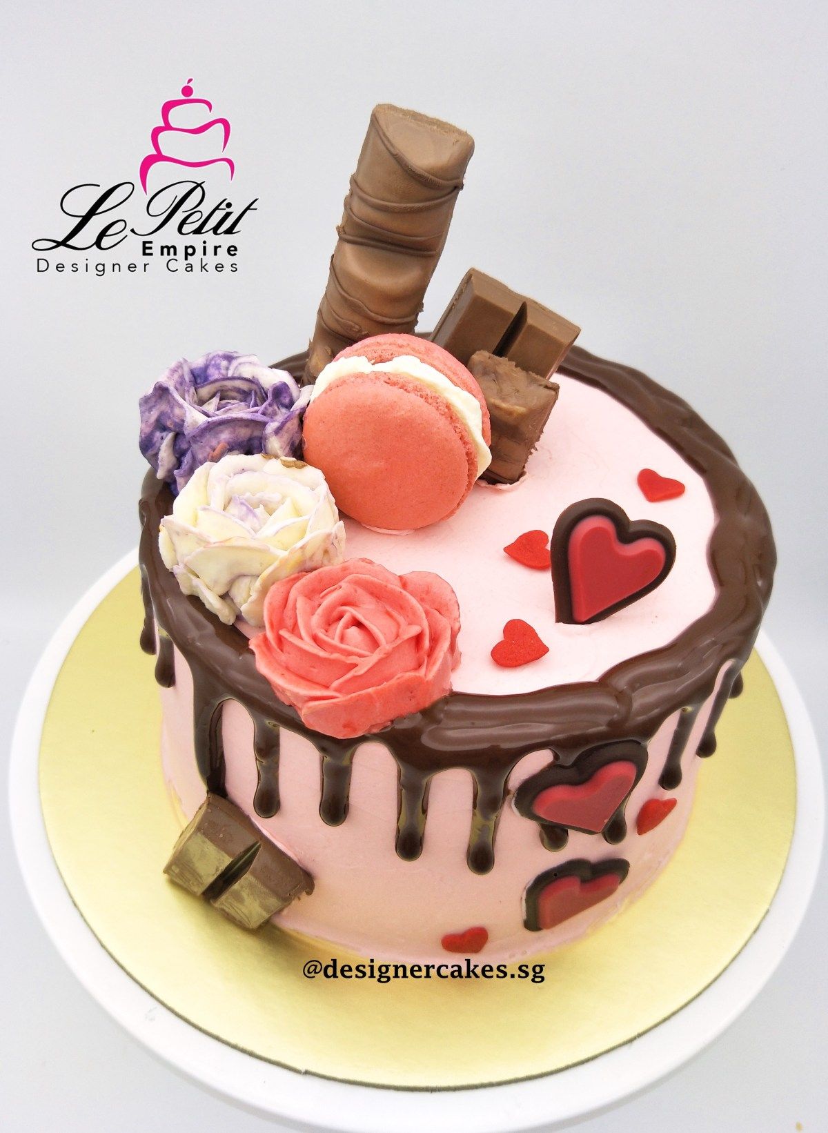 Drip Cake - Pink and chocolate drip cake with butter cream roses, chocolates, macarons and hearts. Singapore Customized Cakes