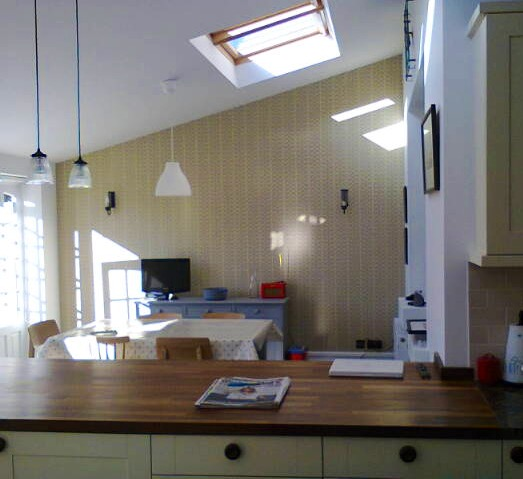 Orla Keely wallpaper and hand painted kitchen units