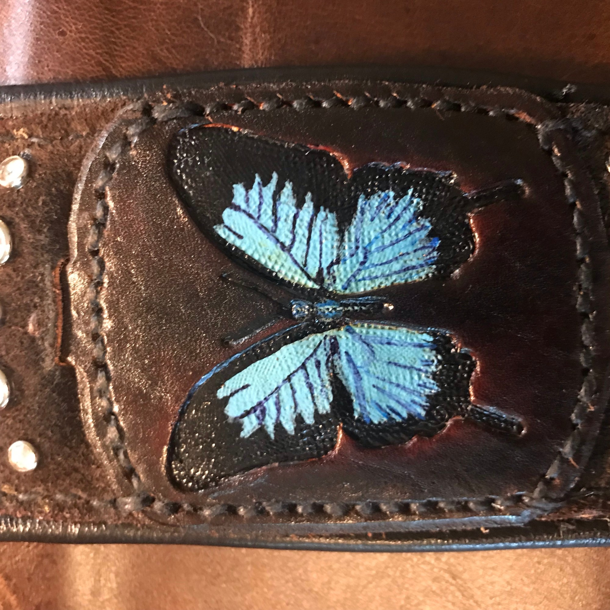 About Designer Leatherworks - Custom Artist Series Guitar Strap featuring Recessed Tooled and Dyed Blue Butterfly