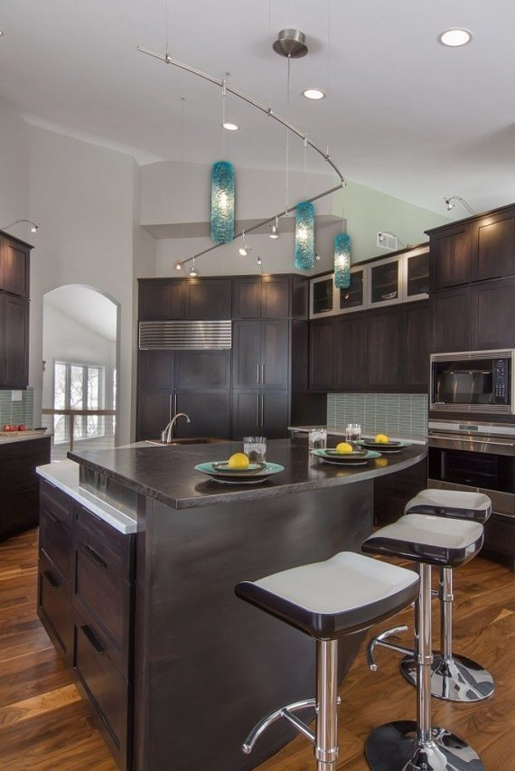 A fun approach to the typical pendent lighting for a kitchen.