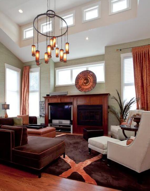 A beautiful light that creates drama and interest but also balances the high ceilings.