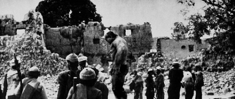 Afghan resistance fighters return to a village destroyed by Soviet forces.