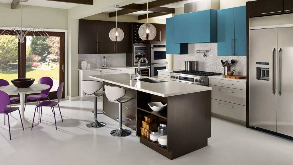 kitchen with white countertops, teal green upper cabinets, stainless tell appliances