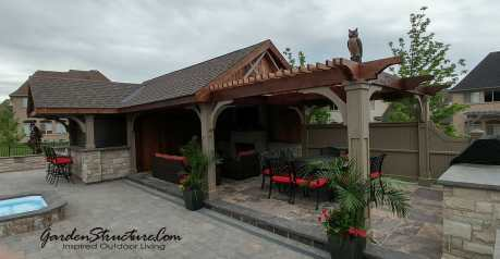 View of outdoor kitchen with pergola