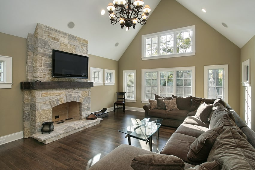 Family Room With Stone Fireplace And Brown Design