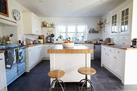 Mid Century Modern Kitchen With White Cabinets Light Wood Counters And Vintage Blue Oven