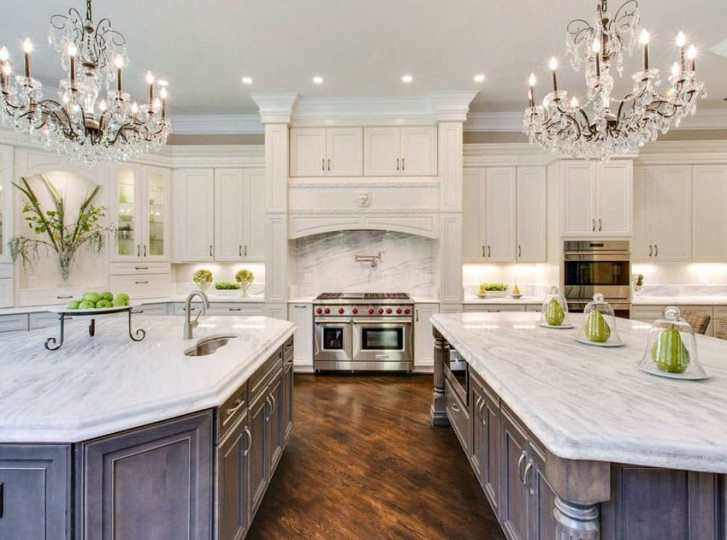 23 Stunning Gourmet Kitchen Design Ideas   Designing Idea 23 Stunning Gourmet Kitchen Design Ideas  Beautiful kitchen with white  cabinets two islands two chandeliers and Carrara marble countertops