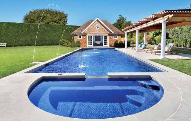 rectangular swimming pool with semi circle hot tub and water fountains
